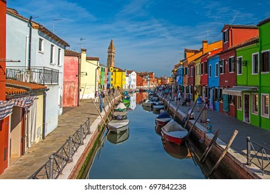 VENICE, ITALY - on JUNE 10, 2017. Burano the island, the street canal and multi-colored houses on the embankment.
