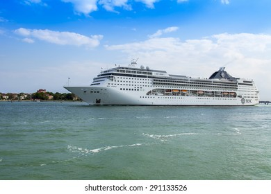 VENICE, ITALY - on MAY 1, 2015. The cruise ship Opera leaves seaport of Venice and passes by Lido's island