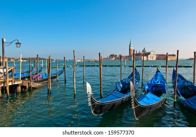 Venice Italy pittoresque view of gondolas  with Saint George island on background