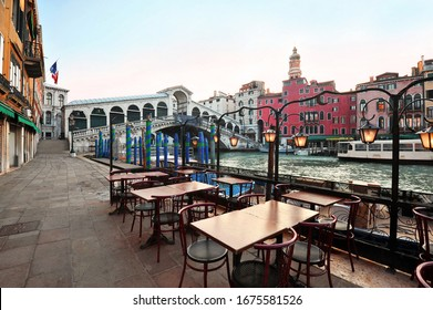 Venice in Italy - Rialto Bridge and Grand Canal with empty embankment,  tourist centre of famous city without people