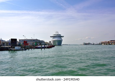 VENICE, ITALY - SEPT 24, 2014: The cruise ships moored in the Venetian port at morning. More than 10 million tourists visit Venice every year