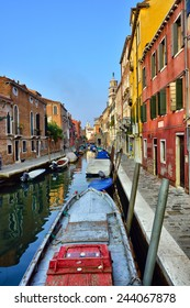 VENICE, ITALY - SEPT 27, 2014: Venice water canal and boat at sunrise. Tourists from all the world enjoy the historical city of Venezia in Italy, famous UNESCO World Heritage Site