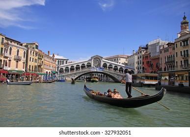 VENICE, ITALY - SEPTEMBER 02, 2012: Gondola at Rialto Bridge on Grand Canal, Venice, Italy