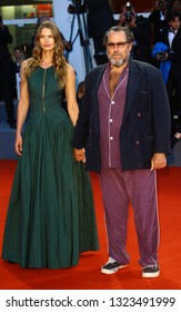VENICE, ITALY - SEPTEMBER 03: Julian Schnabel and Louise Kugelberg walks the red carpet ahead of the 'At Eternity's Gate' screening during the 75th Venice Film Festival on September 3, 2018 in Venice