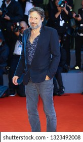 VENICE, ITALY - SEPTEMBER 03: Mathieu Amalric walks the red carpet ahead of the 'At Eternity's Gate' screening during the 75th Venice Film Festival on September 3, 2018 in Venice, Italy