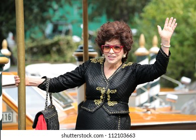 VENICE, ITALY - SEPTEMBER 05: Gina Lollobrigida leave from the hotel Excelsior during the Venice Film Festival on September 05, 2012 in Venice, Italy