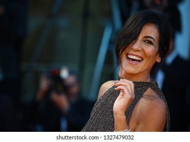 VENICE, ITALY - SEPTEMBER 06:  Paola Turci  walks the red carpet ahead of the 'Capri-Revolution' screening during the 75th Venice Film Festival on September 6, 2018 in Venice, Italy