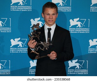VENICE, ITALY - SEPTEMBER 06: Romain Paul with his award for Best Young Actor on stage during the Closing Ceremony during the 71st Venice Film Festival on September 06, 2014 in Venice, Italy