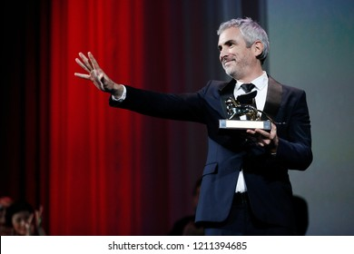 VENICE, ITALY - SEPTEMBER 08: Alfonso Cuaron receives the Golden Lion for the best Film at the Award Ceremony during the 75th Venice Film Festival on September 8, 2018 in Venice, Italy.