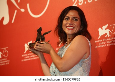 VENICE, ITALY - SEPTEMBER 08:  Soudade Kaadan poses with Lion Of The Future for 'The Day I Lost My Shadow' at the Winners Photocall during the 75th Venice Film Festival on September 8, 2018 in Venice
