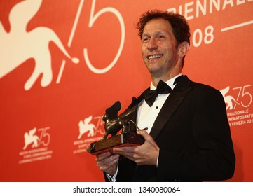 VENICE, ITALY - SEPTEMBER 08: Tim Blake Nelson poses with the Best Screenplay Award for 'The Ballad Of Buster Scruggs' at Winners Photocall during the 75th Venice Film Festival on September 8, 2018