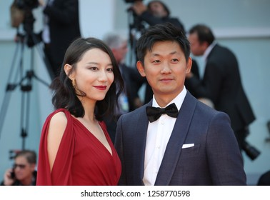 VENICE, ITALY - SEPTEMBER 09: (L-R) Ying Zei and Pengfei from 'The Taste of Rice Flower' movie arrive at the Award Ceremony of the 74th Venice Film Festival