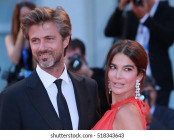 VENICE, ITALY - SEPTEMBER 10, 2016: Kim Rossi Stuart and Ilaria Spada  during the 73th Venice Film Festival 2016 in Venice, Italy
