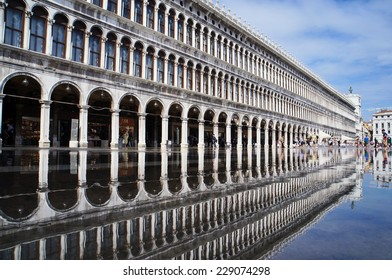VENICE, ITALY- SEPTEMBER 14: The Puddle which reflects Procuratie Vecchie in Piazza San Marco, Venice, Italy on September 14,2014.
