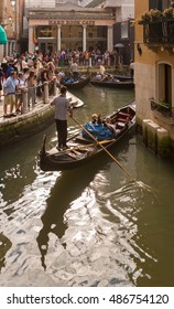 Venice, Italy- September 15, 2016: Tourist and groups roams the narrow streets of Venice.Many tourists take gondola tours to wander around the canals of the city.It is very nice experience