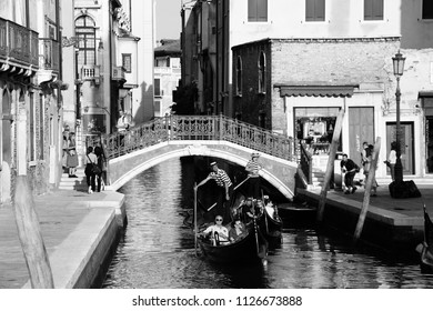 VENICE, ITALY - SEPTEMBER 17, 2009: Gondolas and tourists in Venice, Italy. According to Euromonitor Venice was the 26th most visited city in the world in 2006.