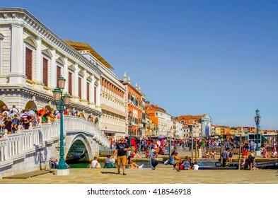 VENICE, ITALY, SEPTEMBER 20, 2015: Tourists on Riva degli Schiavoni against view on Grand Channel and Santa Maria della Salute in Venice, Italia, September 20, 2015.
