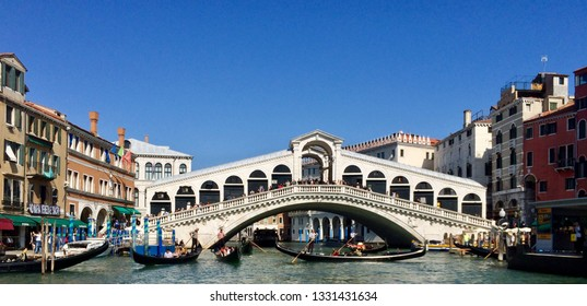 Venice / Italy - September 20 2017: View of Rialto Bridge approaching from boat from Grand Canal, Venice