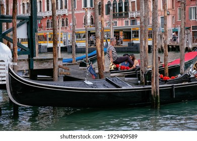 VENICE, ITALY – SEPTEMBER 20, 2020: Gondolier and Tourists at Gondolas in Grand Canal with Traditional Venetian Colorful Houses - Quiet Morning