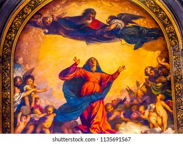 VENICE, ITALY - SEPTEMBER 21, 2017 Titian Assumption Virgin Mary Rise to Heaven  Painting Santa Maria Gloriosa de Frari Church San Polo Venice Italy.  Church completed mid 1400s. Titian Painting  1518