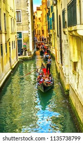 VENICE, ITALY - SEPTEMBER 21, 2017 Small Canal Bridge Buildings Red Fancy Gondolas Boats Reflections Venice Italy.  Gondola Traffic Jam Lots of Gondolas Narrow Canal