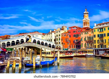 VENICE, ITALY - SEPTEMBER 21, 2017 Colorful Rialto Bridge Public Ferries Vaporetto Ferry Docks Gondola Touirists Grand Canal Venice Italy