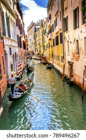 VENICE, ITALY - SEPTEMBER 21, 2017 Gondola Tourists Colorful Small Canal Bridge Buildings Boats Reflections Venice Italy