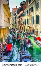 VENICE, ITALY - SEPTEMBER 22, 2017 Gondola Tourists Colorful Small Canal Bridge Buildings Boats Reflections Venice Italy