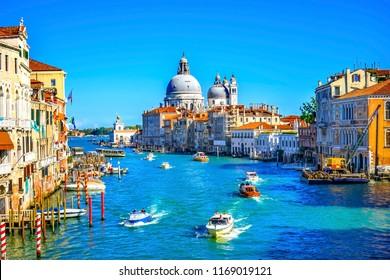VENICE, ITALY - SEPTEMBER 22, 2017 Grand Canal Santa Maria della Salute Church from Ponte Academia Bridge Gondolas Venice Italy