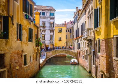 VENICE, ITALY, SEPTEMBER 23, 2017: Traditional narrow canal with gondolas in Venice, Italy
