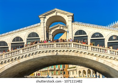 VENICE, ITALY - SEPTEMBER  23, 2017 Rialto Bridge Colorful Grand Canal Touirists Travlers Grand Canal Venice Italy