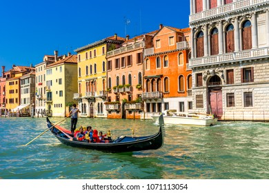 VENICE, ITALY - SEPTEMBER  23, 2017 Colorful Grand Canal Gondola  Reflections Venice Italy