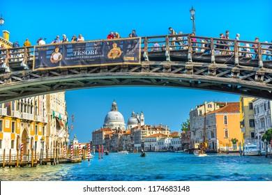 VENICE, ITALY - SEPTEMBER 23, 2018 Colorful Grand Canal  Ponte Academia Bridge Buildings Santa Maria della Salute Church Boats Reflections Venice Italy