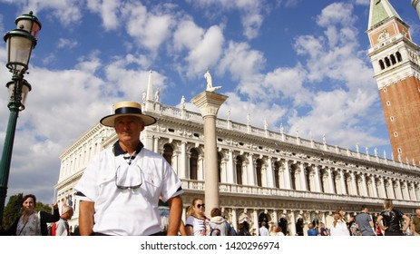 Venice, Italy, September 23, 2018: Portrait of a gondolier in a hat on St. Mark's square in Venice (Italy)