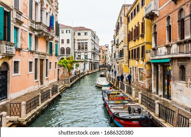 VENICE, ITALY - SEPTEMBER 23, 2019: Venice canal and traditional colorful Venetian houses view. Classical Venice skyline. Venice, Italy.