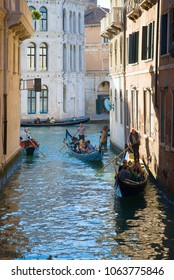 VENICE, ITALY - SEPTEMBER 25, 2017: Gondolas with tourists on the Venetian canals