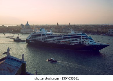 """VENICE, ITALY - SEPTEMBER 26, 2017: Cruise liner """"Azamara Quest"""" in the San Marco Bay on the September twilight"""