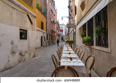 Venice, Italy - September 27, 2013: Tables set for al fresco dining restaurant in Venice.