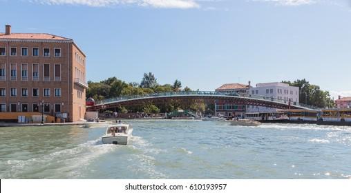 Venice, Italy - September 28, 2015 : Water channels of Venice city. Constitution Bridge (Ponte della Costituzione) in Venice, Italy.