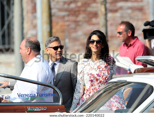 VENICE, ITALY - SEPTEMBER 28: George Clooney and Amal Alamuddin leaves the day after the gala dinner from Aman Hotel in Venice, Italy in September 28, 2014 in Venice, Italy