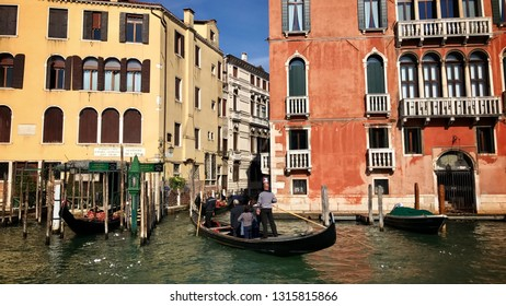 Venice, Italy - September 29, 2017: Passing gondoliers with tourists on the Canale Grande in front of the famous old buildings of Venice, Italy - filmed from a boat on the canal.