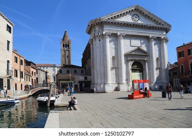 VENICE, ITALY - SEPTEMBER 29, 2018: Tourists take pictures in front of San Barnaba church