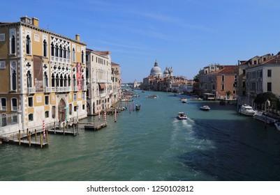 VENICE, ITALY - SEPTEMBER 29, 2018: Boats on the Grand Canal and Santa Maria della Salute church