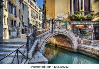 Venice, Italy - September 29, 2018: Historical buildings and small briidge across a canal in Venice, Italy on September 29, 2918
