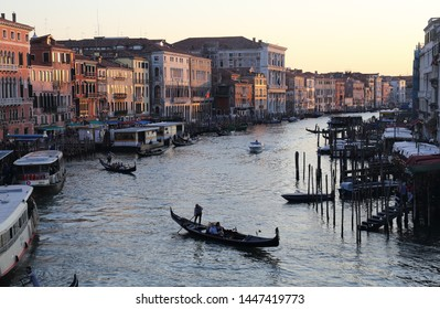 Venice, Italy - September 29, 2018: Historical buildings with hotels and restaurants and boats and gondolas on the Canal Grande in the evening in Venice, Italy on September 29, 2918