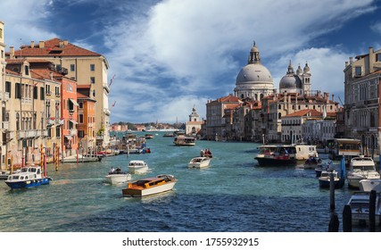 Venice, Italy - September 29, 2018: Boats on the Grand Canal and Santa Maria della Salute church in Venice, Italy on September 29, 2918