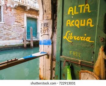 VENICE, ITALY - SEPTEMBER 3, 2013: Sign of bookstore Alta Acqua Libreria, famous bookshop in Venice, Italy