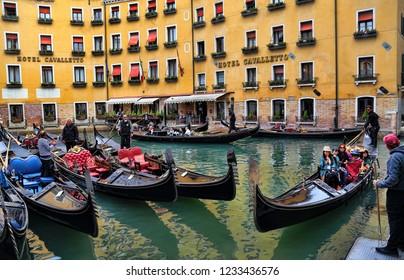 Venice, Italy - September 30, 2018: Gondolas with tourists in Venice, Italy on September 30, 2918