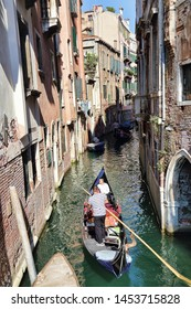 Venice, Italy - September 30, 2018: Gondolas with tourists in a canal in Venice, Italy on September 30, 2918