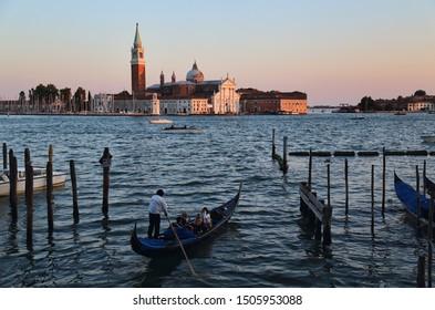 Venice, Italy - September 30, 2018: Gondola and the island and church of San Giorgio Maggiore in Venice, Italy on September 30, 2918